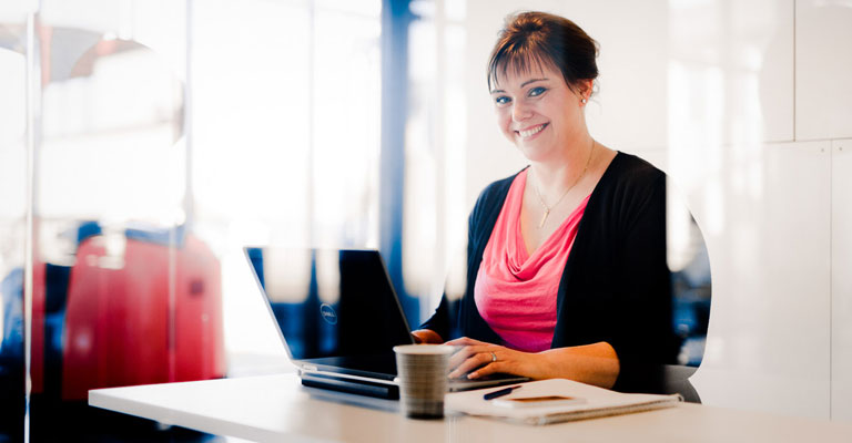 Woman sitting at a desk smiling
